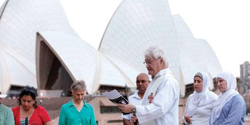 Columban Fr Charles Rue offering prayer at the Multi-faith Prayer Vigil for Climate Action in Sydney. (Photo Credit: Jeff Tann. Vigil event organised by the Australian Religious Response to Climate Change (ARRCC) in partnership with the Faith Ecology Network (FEN) and Catholic Earthcare Australia).